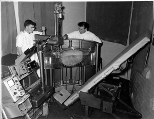 Dave Robinson, George Kossoff checking rail alignment of Mk I scanner, Royal Hospital for Women (late 1962)