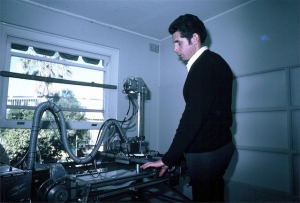 Ian Shepherd examining rails of breast scanner for pitting (1969)