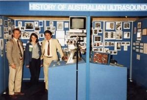 Graham Lange, Belinda Moses, Ian Shepherd with history display at WFUMB'85